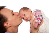 Young father kissing his cute little baby — Stock Photo