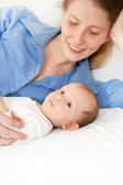 Loving mother with her cute newborn baby — Stock Photo