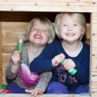 Two vivacious beautiful little blond twin girls — Stock Photo #45163165
