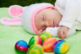Baby in a bunny hat with Easter Eggs — Stock Photo