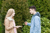 Young teenage couple having a heated discussion — Stock Photo