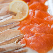 Smoked salmon and fish fillets on a buffet — Stock Photo