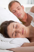 Attractive young woman sleeping peacefully in bed — Stock Photo