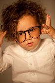 Funny little boy trying round eyeglasses — Stock Photo