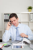 Confident accountant talking on mobile phone — Stock Photo