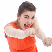 Excited woman punching with her fists — Stock Photo