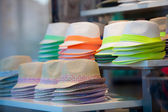 Trendy hats with colorful ribbons for sale — Stock Photo