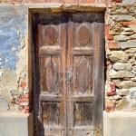 Old wooden door. Serralunga D'Alba, Italy. — Stock Photo #10191630