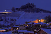 Snowy hill at evening. Alba, Italy. — Stock Photo