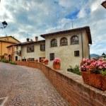 Old houses and narrow street. Barolo, Italy. — Stock Photo