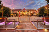 Carousel at evening in city center. Alba, Italy — Stock Photo