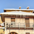 House with icicles. Piedmont, Italy. — Stock Photo