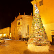 Stock Photo: Christmas tree on small plaza. Alba, Italy.