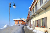 Narrow snowy street in small town. Diano D — Stock Photo