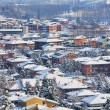 Small town covered by snow. Piedmont, Italy. — Stock Photo