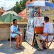 Street painter on Charles Bridge in Prague. - ストック写真