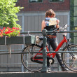 Tourist with map and bicycle. Amsterdam, Netherlands. — Stock Photo #19047667