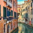 Royalty-Free Stock Photo: Small canal among old houses. Venice, Italy.