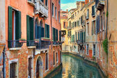 Small canal among old houses. Venice, Italy. — Stock Photo