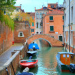 Royalty-Free Stock Photo: Boats on canal among houses. Venice, Italy.
