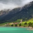 Small village and alpine lake in Switzerland. — Stock Photo