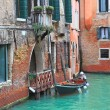 Boat and old brick house in Venice, Italy. — Stock Photo