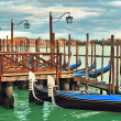 Gondolas moored in row on Grand canal in Venice. — Stock Photo #22807578