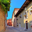 Narrow cobbled street in town of Guarene, Italy. — Stock Photo