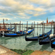 Gondolas moored in row on Grand canal in Venice. — Stock Photo #23920961