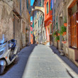 Постер, плакат: Scooter on narrow street in Ventimiglia Italy