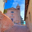 Old church and narrow street. Monticello D'Alba, Italy. — Stock Photo
