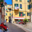 Small plaza among colorful houses in Ventimiglia, Italy. — Stock Photo