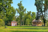Green lawns among trees in Racconigi Park, Italy. — Stock Photo