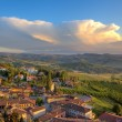 Small italian town on the hills at sunset. — Stock Photo