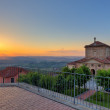 Church and hills of Langhe at sunset. — Stock Photo