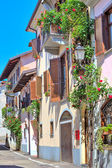 Italian house decorated with flowers in Piedmont, Italy. — Stock Photo