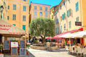 Restaurants and bars in Menton, France. — Stock Photo