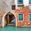 Stock Photo: Red brick house on small canal in Venice, Italy.
