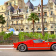 Red luxury car in front of Hotel de Paris at Monte Carlo, Monaco — Stock Photo