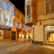 Stock Photo: Illuminated street at night. Alba, Italy.