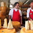 Cheesemakers and wheels of Parmesan in Italy. — Stock Photo