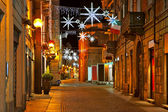 Central street at evening. Alba, Italy. — Stock Photo