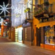 Stock Photo: Christmas illumination on street at evening in Alba, Italy.