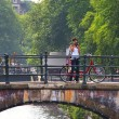 Woman take pictures standing on bridge in Amsterdam. — Stock Photo