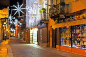 Christmas illumination on street at evening in Alba, Italy. — Stock Photo