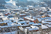 Small town covered with snow in Piedmont, Italy. — Stock Photo
