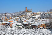Small town and medieval tower covered with snow. — Stock Photo