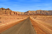 Road through red mountains in Israel. — Stock Photo