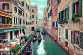 Restaurant on small canal in Venice, Italy. — Stock Photo