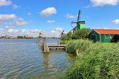 Wooden windmills in dutch village. — Stock Photo